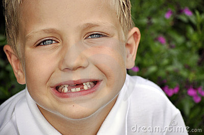 Cute young boy showing his teeth