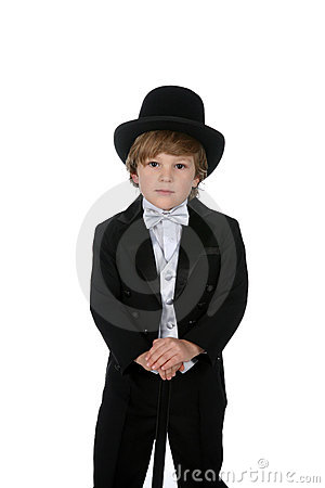 Cute young boy in tuxedo and top hat