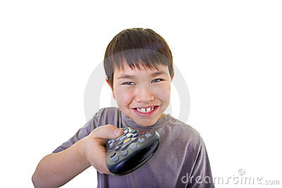 Cute young boy using the remote control isolated