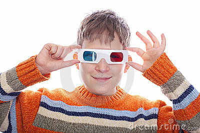 Cute young boy wearing 3D glasses