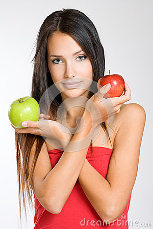 Free Cute Young Brunette Holding Two Apples. Royalty Free Stock Photo - 27047795