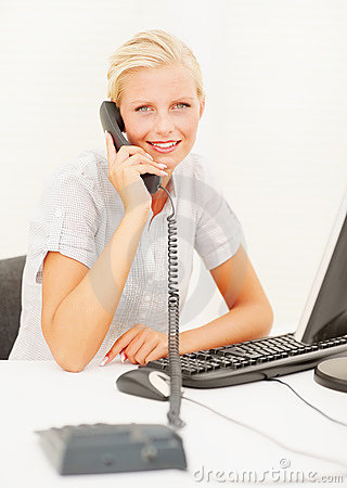 Cute young business woman speaking on  phone