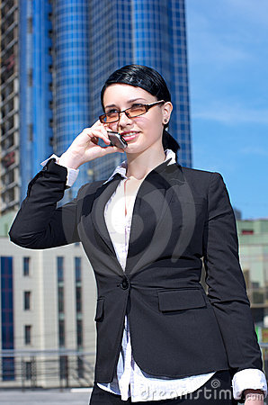 Cute young businesswoman talking Stock Photo