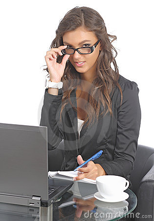 Cute young businesswomen at her desk