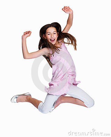 Cute young Caucasian girl jumping with joy