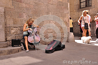 Cute young cellist street musician Editorial Photography