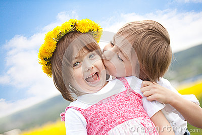Cute young children kissing