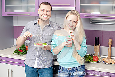 Cute young couple eating healthy breakfast together