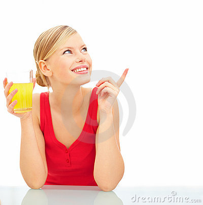 Cute young female pointing at copyspace