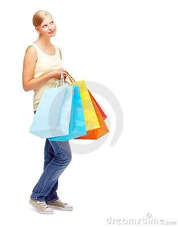 Cute young female with shopping bags on white