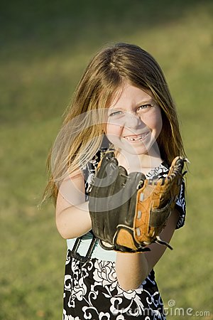 Cute Young Girl With A Baseball Stock Photo - Image: 5625750