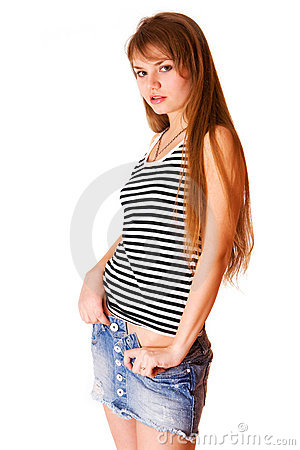 Cute young girl in blue jeans skirt