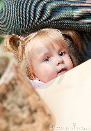 Cute young girl hiding