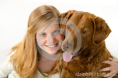 Cute  young girl holding a dog