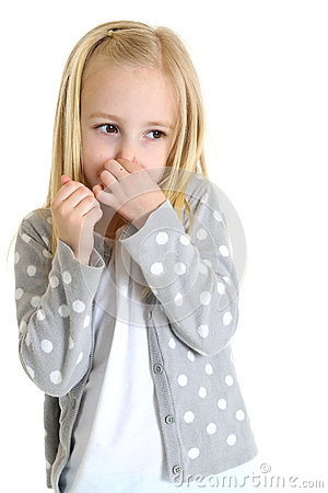 Cute young girl holding her nose from a bad smell