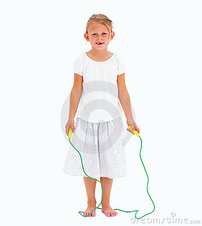 Cute young girl holding skipping rope