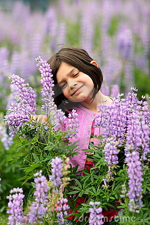 Cute Young Girl in Patch of Purple Wild Flowers