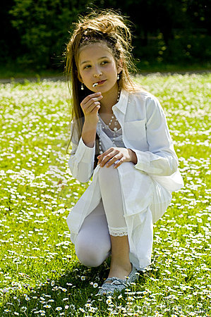 Cute young girl picking flowers