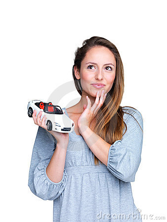 Cute young girl planning to buy a stylish new car