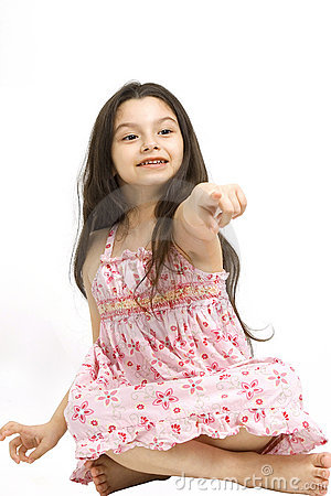 Cute young girl pointing