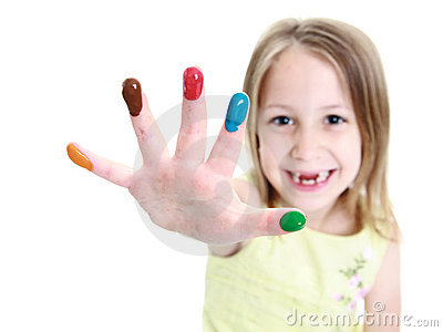 Cute young girl showing finger paints on her hand