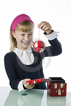 Cute young gril holding a Christmas bauble
