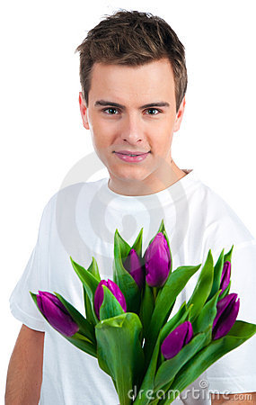 Cute young men give the flowers