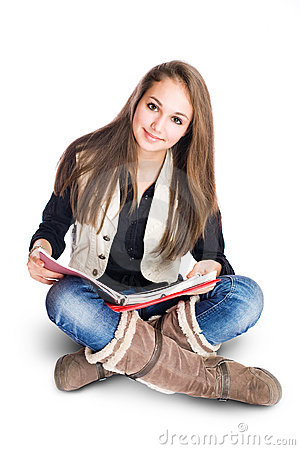 Cute young student girl sitting and reading.