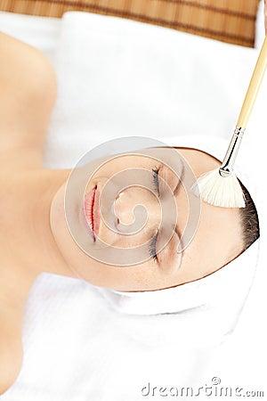 Cute young woman enjoying beauty treatment