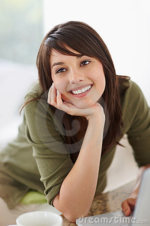 Cute young woman lost in happy thoughts