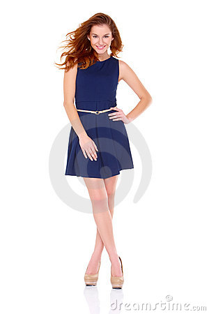 Cute young woman in navy blue dress on white