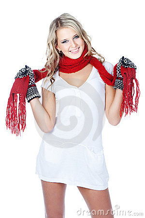 Cute young woman wearing winter clothing on white