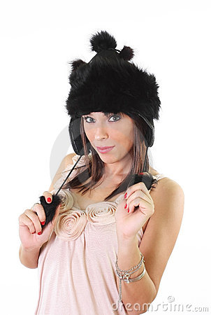 Cute young woman in winter fur hat