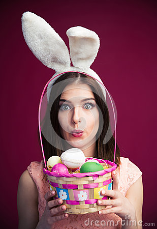 Free Cute Young Woman With An Easter Egg Basket Stock Images - 52296514