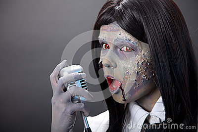 Cute zombie girl with retro microphone