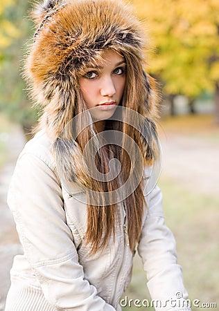 Cuteness in fur hat.