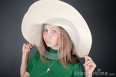 Nice girl in a big straw hat