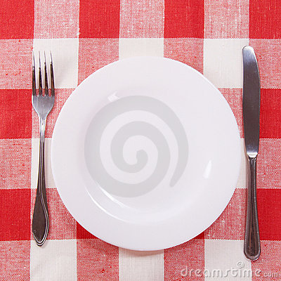 Cutlery on checkered tablecloth