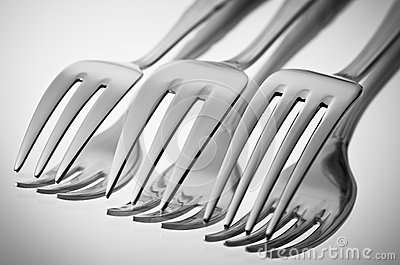 cutlery (forks) on a mirror  in a black-and-white
