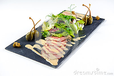Cuts of meat with salad