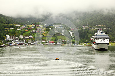 Cutter floats to shore with coastal village Editorial Image