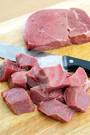 Cutting beef into cubes
