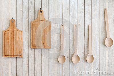 Cutting Boards And Wooden Spoons Hanging On The Wall Stock
