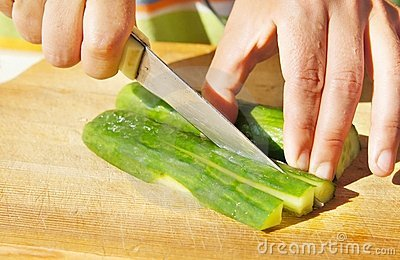 Cutting of cucumber for salad