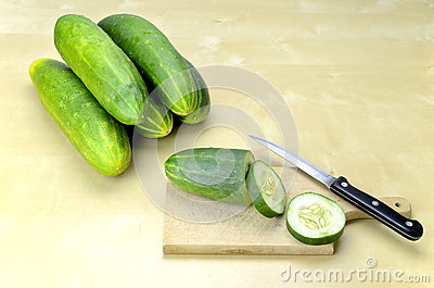 Cutting fresh cucumber in slices
