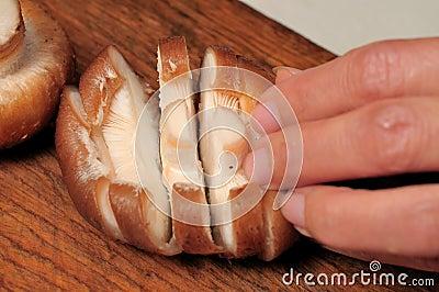 Cutting fresh mushroom