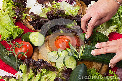 Cutting fresh vegetables for salad