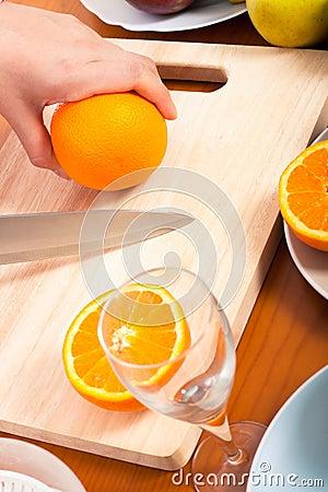 Cutting healthy fresh orange