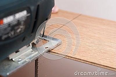 Cutting a laminated floor board