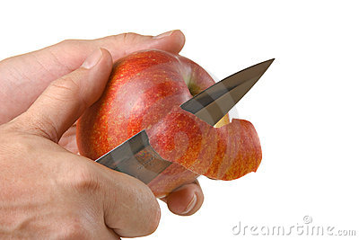 Cutting peel an apple with a knife